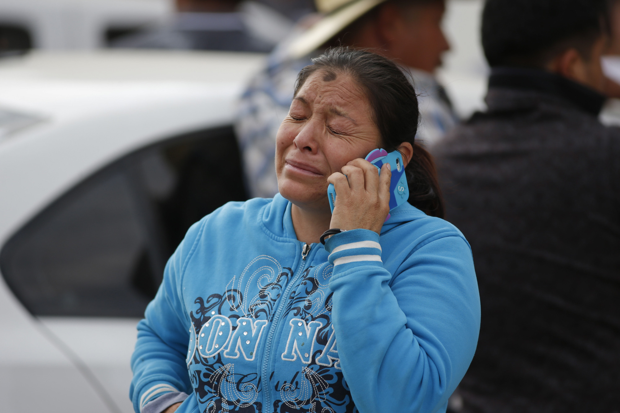 A woman cries outside a funeral service for one of the dozens of victims of the pipeline fire in Tula, Mexico, on Saturday. | AP