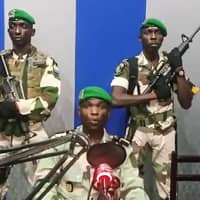 Video footage posted on YouTube on Monday shows Gabon soldiers on state radio calling on the people to 'rise up' and announcing that a 'national restoration council' would be formed, as an ailing President Ali Bongo is out of the country. | AFP-JIJI