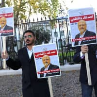People protest the murder of Saudi journalist Jamal Khashoggi in Turkey outside the Saudi Embassy in London Oct. 26. | REUTERS