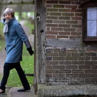 British Prime Minister Theresa May leaves after attending a church service near her Maidenhead constituency, west of London, on Sunday. May on Sunday warned MPs preparing to vote down her EU divorce deal that failing to deliver Brexit would be a 'catastrophic and unforgivable breach of trust in our democracy.' | AFP-JIJI