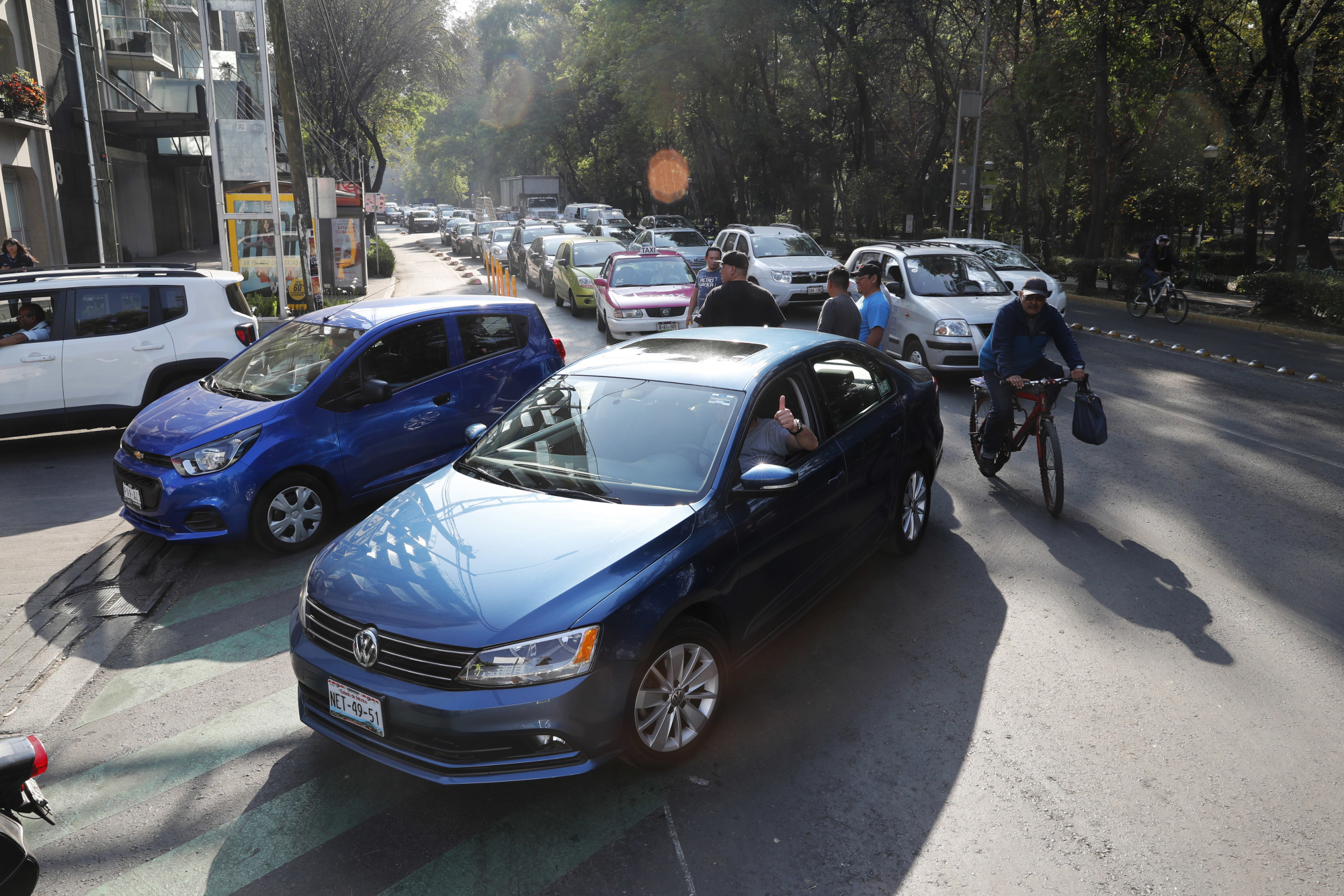 Vehicles stand in line to fill up their fuel tanks at a gas station in Mexico, City Wednesday. A fuel scarcity arose after President Andres Manuel Lopez Obrador decided to close government pipelines riddled with illegal fuel taps drilled by thieves, and instead deliver gas and diesel by tanker trucks. | AP