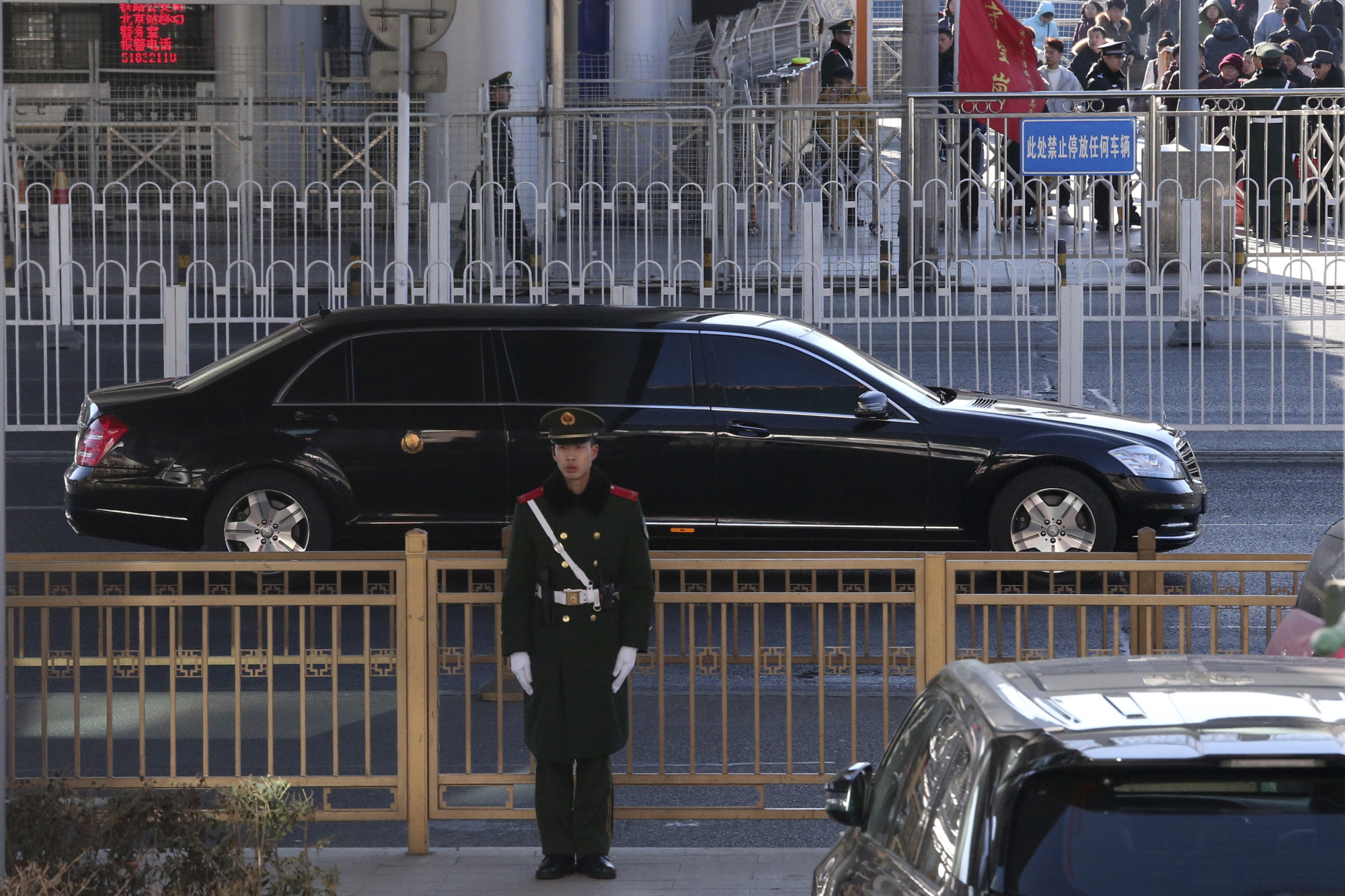 A limousine believed to be carrying North Korean leader Kim Jong Un leaves a train station with a convoy in Beijing on Tuesday. | AP