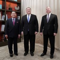 U.S. Secretary of State Mike Pompeo (center) poses with Kim Yong Chol, vice chairman of the North Korean Workers' Party Committee and the North's lead negotiator in nuclear diplomacy with the United States, and U.S. Special Representative for North Korea Stephen Biegun as they start talks aimed at clearing the way for a second U.S.-North Korea summit, at a hotel in Washington on Friday. | REUTERS