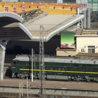 A train similar to one seen during previous visits by North Korean leader Kim Jong Un arrives at Beijing Railway Station in the Chinese capital on Tuesday. | AP