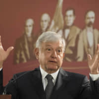 Mexico's President Andres Manuel Lopez Obrador holds his first news conference as president on Dec. 3 in Mexico City. | AP