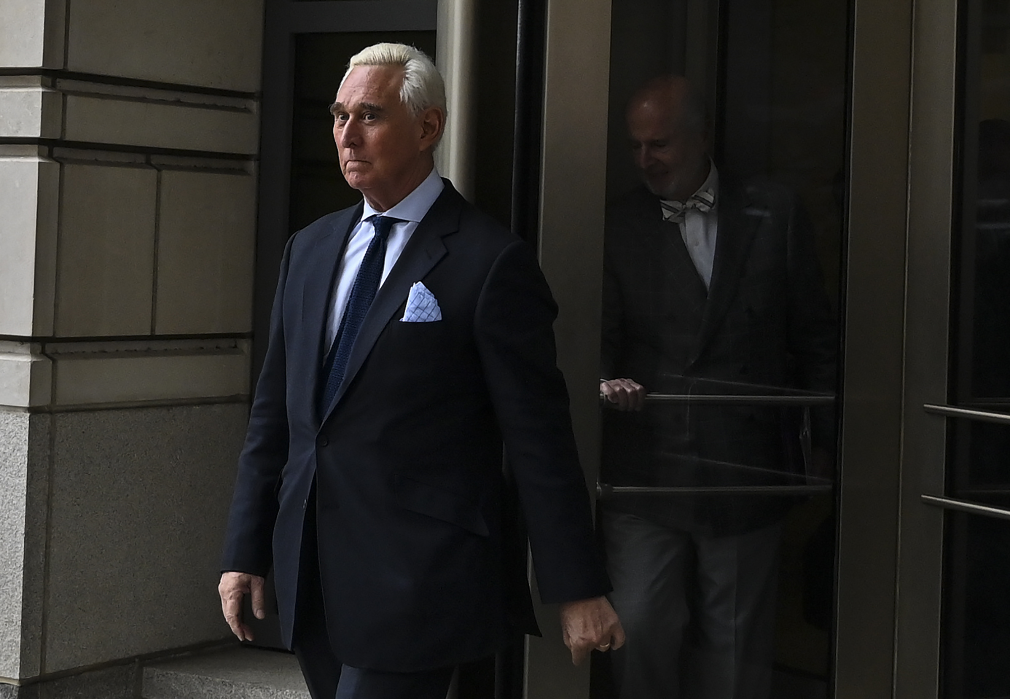 Roger Stone leaves after his arraignment, as part of the Robert Mueller probe, at the U.S. District courthouse in Washington Tuesday. Longtime Donald Trump advisor Stone pleaded not guilty on Tuesday to charges stemming from the ongoing investigation into whether the president's campaign colluded with Russia in the 2016 election. Stone, 66, is charged with lying to Congress, witness tampering and obstruction in relation to his contacts with WikiLeaks, whose publication of embarrassing Russian-hacked communications from Democrat Hillary Clinton's campaign gave a boost to Trump. | AFP-JIJI