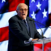 Former New York Mayor Rudy Giuliani speaks at the 2018 Iran Freedom Convention in Washington last May. | REUTERS