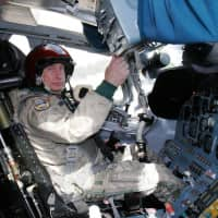Russian strongman Vladimir Putin sits in the cockpit of Tupolev Tu-160 strategic bomber at a military airport outside Moscow in August 2005. The U.S. military said that fighter jets were scrambled after two nuclear-capable Russian Tu-160s entered Canada's air defense identification zone on Saturday in the Arctic region near the North American coastline. | AFP-JIJI