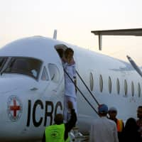 Saudi prisoner Moussa Awaji gestures as he boards an ICRC plane at the Sanaa airport after he was released by the Houthis in Sanaa Tuesday. | REUTERS