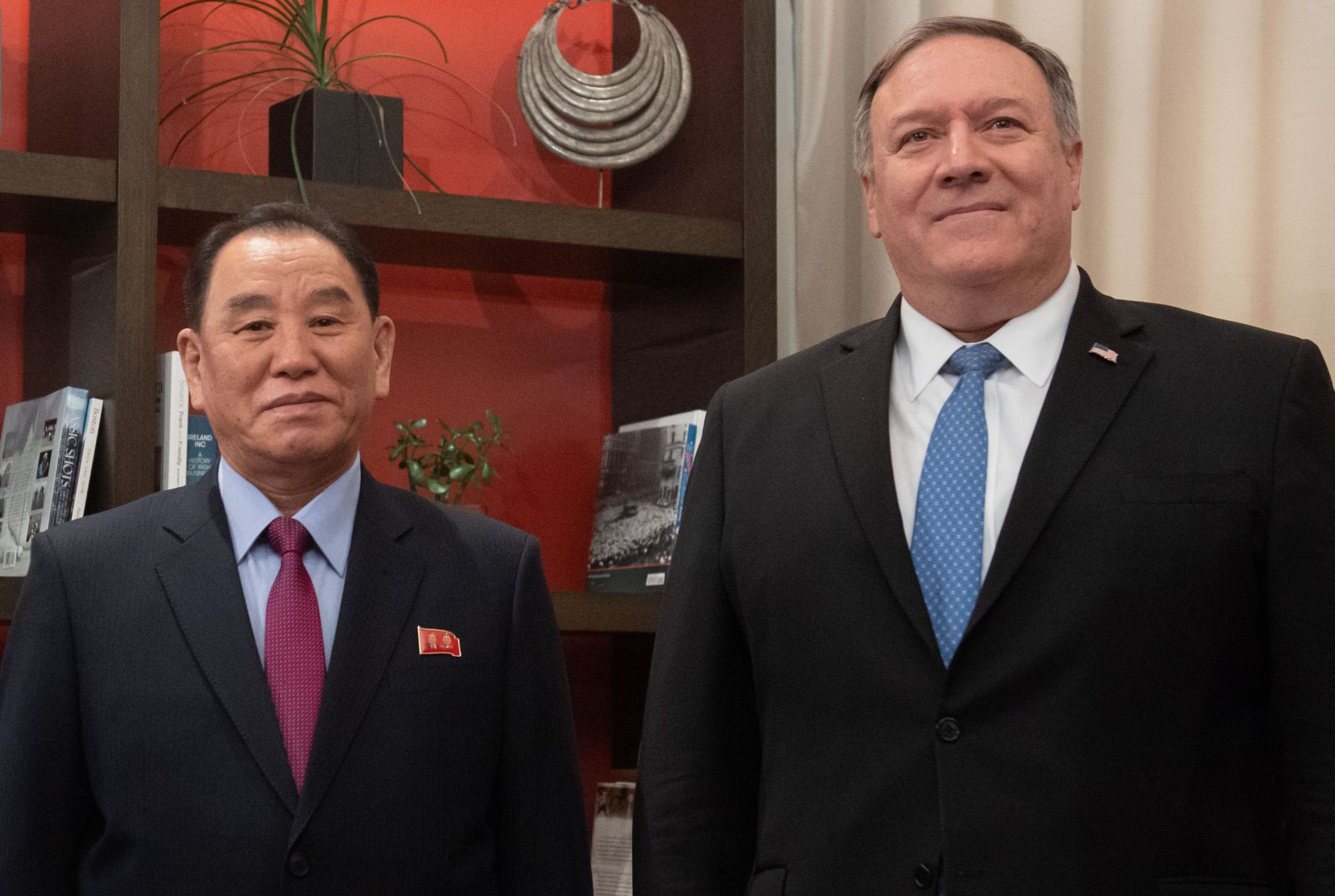 U.S. Secretary of State Mike Pompeo welcomes North Korean Vice-Chairman Kim Yong Chol prior to a meeting in Washington Jan. 18. Pompeo held talks on North Korea with his Japanese and South Korean counterparts ahead of a summit between Pyongyang's leader and the U.S. president, the State Department said Monday. The phone calls, which took place on Sunday, come after President Donald Trump announced that a location for his summit with Kim Jong Un has been decided. | AFP-JIJI