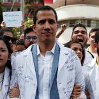 Venezuelan opposition leader and self-proclaimed interim president Juan Guaido takes part in a protest against Venezuelan President Nicolas Maduro's government outside the hospital in Caracas Wednesday. | REUTERS