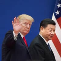 U.S. President Donald Trump and Chinese President Xi Jinping leave a business leaders event at the Great Hall of the People in Beijing in November 2017. | AFP-JIJI