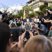 Juan Guaido speaks during a rally to propose amnesty laws for police and military members in Caracas on Saturday. | BLOOMBERG