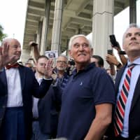 Attorneys Bruce Rogow (left) and Robert Buschel flank their client, Roger Stone, after his appearance at Federal Court in Fort Lauderdale, Florida, Friday. | REUTERS