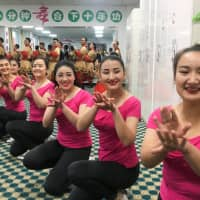 Residents perform for reporters and government officials during a government organized visit to the Hotan county vocational educational training center in Hotan county, Xinjiang Uighur Autonomous Region, China, Saturday. | REUTERS