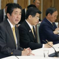 Prime Minister Shinzo Abe speaks during a meeting with senior ruling lawmakers and top government officials on Tuesday at the Prime Minister's Office in Tokyo.   KYODO