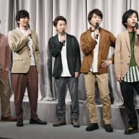 Members of the boy band Arashi attend a news conference Sunday evening in Minato Ward, Tokyo. | KYODO