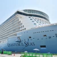 The 168,000-ton cruise ship Quantum of the Seas arrives at Kochi New Port in the city of Kochi in June 2017. | KYODO