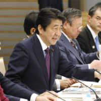 Abe's plan to battle Japan's regional brain drain draws mixed reviews