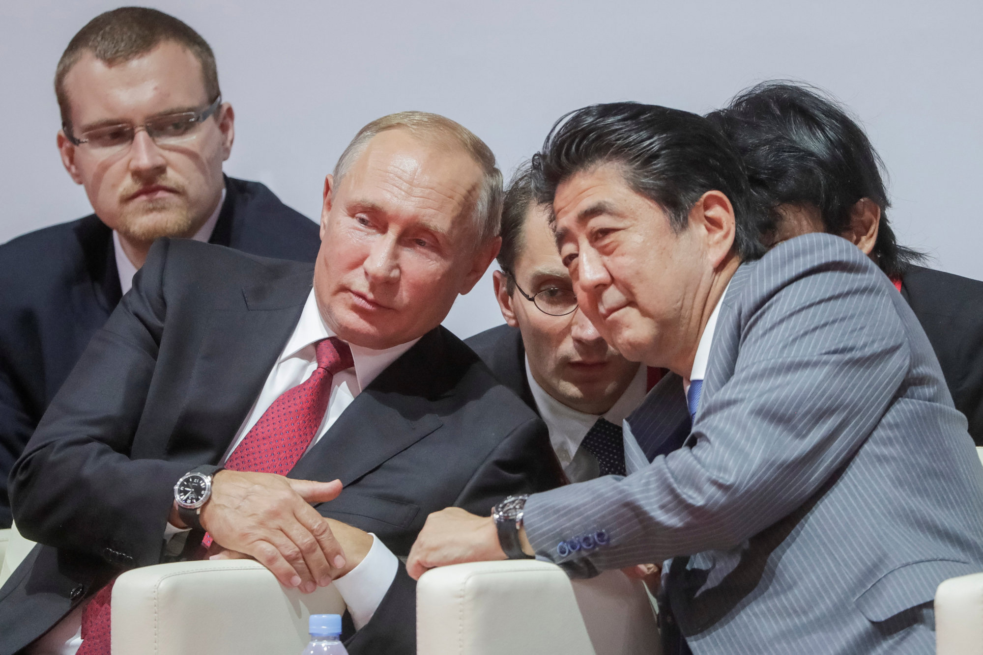 Russian President Vladimir Putin and Prime Minister Shinzo Abe watch an international judo tournament on the sidelines of the Eastern Economic Forum in Vladivostok, Russia, in September. The two are trying to lay the groundwork for reaching an agreement this year on a long-standing territorial dispute. | REUTERS
