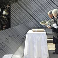 Emperor and Empress mourn for civilian sailors slain during WWII