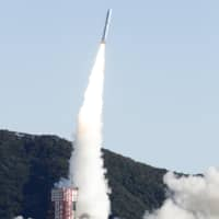 An Epsilon-4 rocket lifts off from Uchinoura Space Center in Kagoshima Prefecture on Friday morning. | KYODO