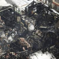 Houses that were burned down in an early morning fire Wednesday on Sado Island. | KYODO