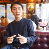 Takuya Yamase speaks Dec. 16 in Tokyo about his efforts in Cambodia to help impoverished villagers. | MAGDALENA OSUMI