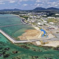 About 20 percent of the planned reclamation work in this area of the Henoko coastal district in Okinawa Prefecture, seen Jan. 13, has been completed. | KYODO
