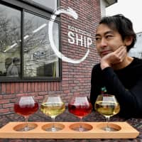 Kantaro Oizumi, president and CEO of Oizumi Kojo, sits outside his kombucha brewery. Captivated by the health drink, Oizumi decided to launch Japan's first full-scale kombucha brewery in 2016 with the help of brewer Yuji Shimada. | YOSHIAKI MIURA