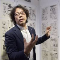 Manga artist Naoki Urasawa speaks about his work during a preview of his exhibition in  Hollywood on Wednesday. | KYODO