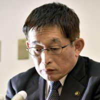 Akashi Mayor Fusaho Izumi, speaking at a news conference Tuesday, apologizes for verbally abusing a senior city official in June 2017. | KYODO