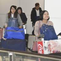 Three Myanmar women who will participate in the foreign trainee program as nursing care workers are seen at Hokkaido's New Chitose Airport, near Sapporo, following their arrival Monday morning. | KYODO