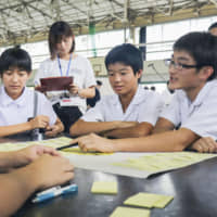 Students at Yamazato Junior High School in the city of Nagasaki take part in a discussion held as part of a 'peace education' class in September. | KYODO