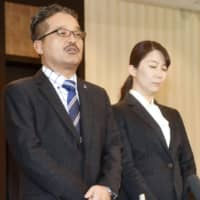 Takumi Matsumura (left), a senior manager at AKS, and Maiko Hayakawa, a newly appointed manager at the firm, speak to reporters in Tokyo on Monday. | KYODO