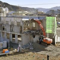 Work to demolish the former town hall, where dozens of people died when it was hit by the March 11, 2011, tsunami, begins in Otsuchi, Iwate Prefecture, on Saturday. Some residents wanted the building to be preserved as a memorial. | KYODO