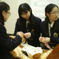 Students in Nekorobu, an animal welfare club at Yamate Gakuin Junior and Senior High School in Yokohama, meet up to twice a month to work on projects, discuss future plans and spend time together. | RYUSEI TAKAHASHI