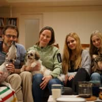 The Johanssons have been fostering animals for more than three years at their home in Yokohama. Germund (left), Veronica (second from left), Ebba (second from right) and Nora live with Yama, a 7-year-old dog, and Lilly, a 1-year-old cat. Currently they're fostering an 11-year-old dog named Stromboli, who spends a good portion of his time waiting for food by the kitchen door or wandering around the house with his tongue out. | RYUSEI TAKAHASHI