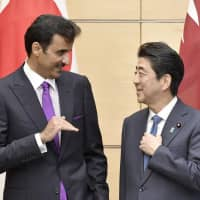 Qatari Emir Sheikh Tamim bin Hamad Al Thani talks to Prime Minister Shinzo Abe after their meeting in Tokyo on Tuesday. | KYODO