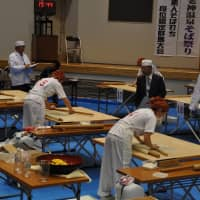 Officials of the Japan Council for Interregional Soba Culture Exchange examine contestant's soba-making skills in Numata, Gunma Prefecture, on Sept. 29. | KYODO