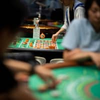 Students practice at the Japan Casino School in Tokyo last June. | AFP-JIJI