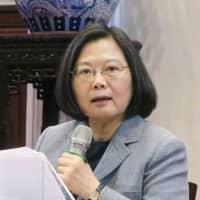 Taiwan President Tsai Ing-wen speaks with foreign media at the Presidential Office in Taipei on Saturday. | KYODO