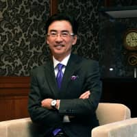 Seiko Holdings Corp. CEO Shinji Hattori poses at his office in the Ginza district of Tokyo. He hopes to expand his firm's market in places like Dubai and Singapore, and attract travelers who come to Japan for quality Japan-made products. | YOSHIAKI MIURA