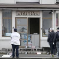 A 22-year-old man was arrested Thursday for attempted murder after he attacked an officer at this police substation in the city of Toyama. | KYODO