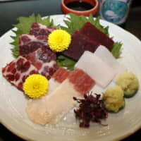 Whale meat is served at a restaurant in Osaka on Dec. 26. | KYODO