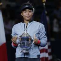 A talk worth having: Naomi Osaka holds her trophy at the women's final of the U.S. Open tennis tournament in New York. | AP