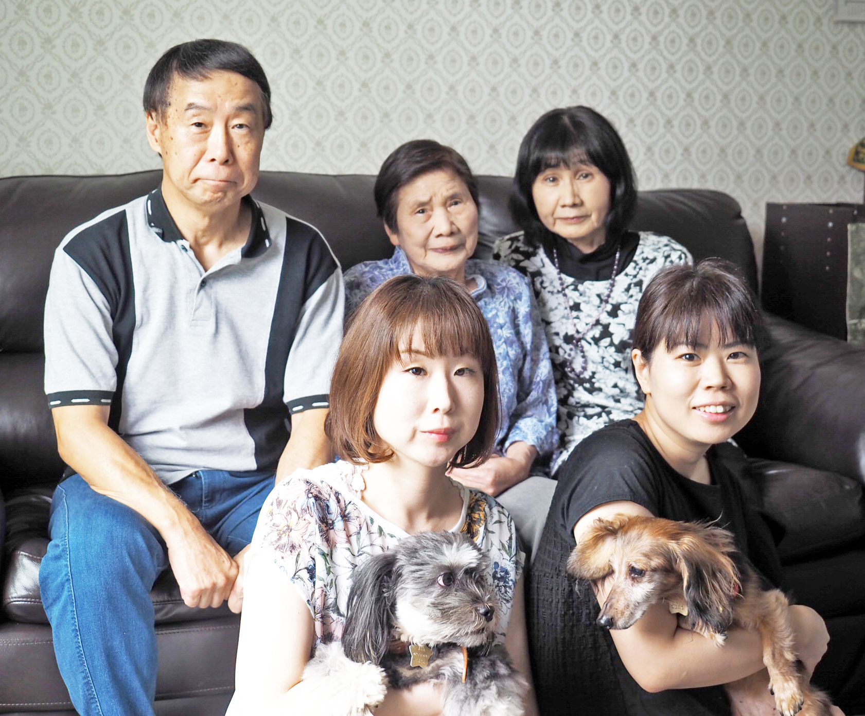 The Taguchi family includes (back row, from left) father Yuichi, grandmother Fujie, mother Chiyoko and, in the front row, sisters Reina and Ai. Reina holds Shishimaru and Ai holds the late Minnie, who was also an adopted pet.   AI TAGUCHI