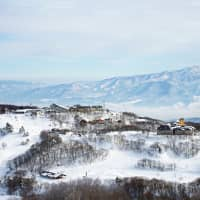 See the sea while you ski: The ski village of Madarao as seen from the slopes, with the Sea of Japan in the far distance. | OSCAR BOYD