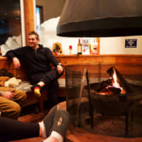 Evening comforts: One of the main attractions of Raicho Lodge is its communal fireplace, perfect for a post-ski hot chocolate. | OSCAR BOYD