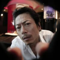 Peeping Tom: The seedy underbelly of a love hotel forms the basis of 'Divine Justice,' with Hiroshi Mikami taking center stage as a police officer with dubious morals. | © 2018 SOULAGE